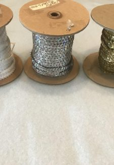 spools of single strand sequins
